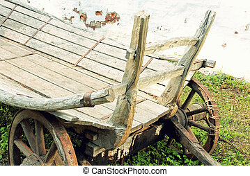 Old wooden cartToned image - Old wooden cart taken...