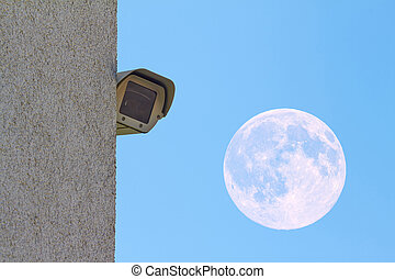 security - A new security camera is mounted on a wall