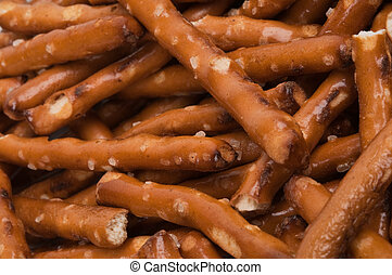 Pretzel Sticks - Several pretzel sticks lying on top of...