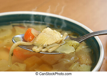 Hearty Chicken Noodle Soup - A steaming hot bite of some...