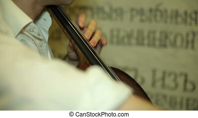 playing the cello, close up. musician playing the cello