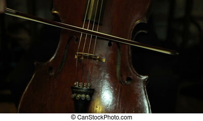 Antiques. Manual Movie - playing the cello, close up....