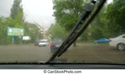 Traffic In the City During Heavy Rain - Slow motion shot of...
