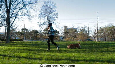 Young Girl Running In Park With Her Pet