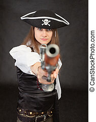 Woman - pirate aims in us from an ancient pistol - The woman...