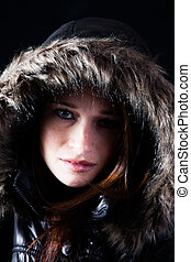 Woman in fur coat - Pretty woman in fur coat with hood over...