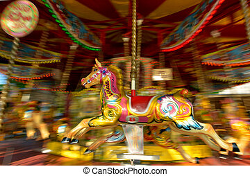 Motion blurr of vintage horse of amusement ride on...