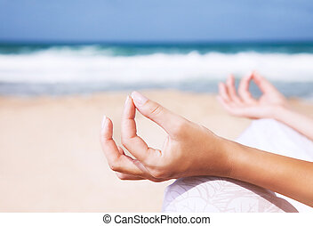 Yoga and zen balance concept - Woman sitting on the beach in...