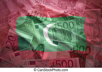 colorful waving maldives flag on a euro money background