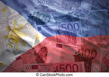 colorful waving philippine flag on a euro money background