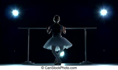 Ballerina in white tutu makes you lean forward. back view -...