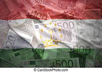 colorful waving tajikistan flag on a euro money background