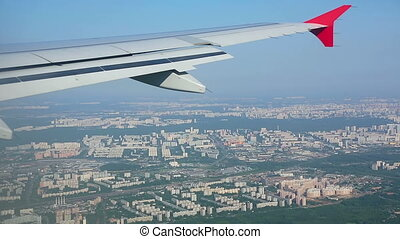 Aerial view from descending airplane Under the wing -...