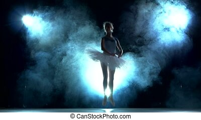 ballerina doing a workout in the classroom. Smoke, fog,...