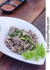 Blanched beef served with fresh green vegetable