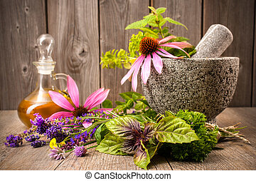Alternative medicine - Healing herbs with mortar and bottle...