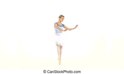 Ballerina is wearing  white tutu and pointe shoes