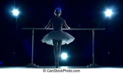 Ballerina makes you lean forward. back view. slow motion
