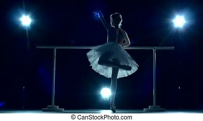 Young Ballerina makes you lean forward. back view. slow motion