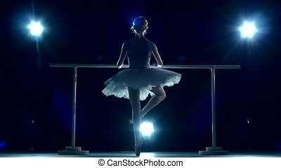Young Ballerina makes you lean forward. back view. slow...