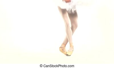 Young ballerina dancing, closeup on legs and shoes, standing...