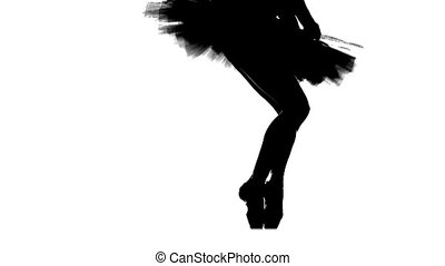 Silhouette ballerina dancing, closeup on legs and shoes,...