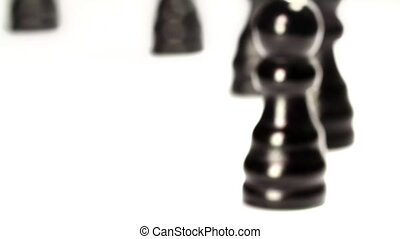 Chess sets march Close up - Black chess pieces crossing in a...