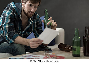 Man drinking alcohol and looking at photos - Sad man...