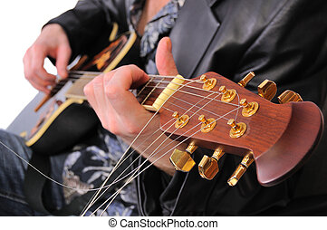 musician plays his acoustic guitar - this is a close up of a...