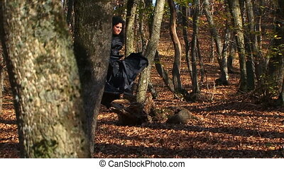 Woman In Black Running In Autumn Forest