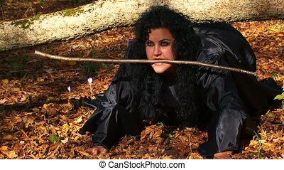 Dark Haired Woman In Black Creeping In Autumn Forest - This...
