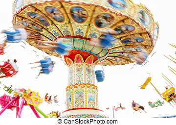 Colorful merry-go-round - Children riding a colorful...