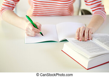 close up of female hands with book and notebook - people and...