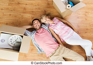 couple with big cardboard boxes moving to new home - home,...