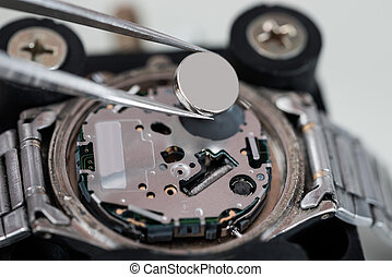 Tweezers With Battery And Wrist Watch - Close-up Of Tweezers...