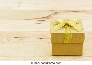 Golden gift box with ribbon bow - Golden gift box with...