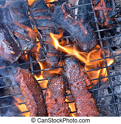 Sausage on a grill - Picture of a Fat Sausage on a grill,...