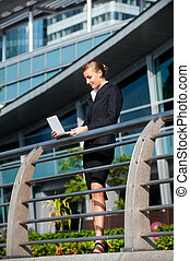 Businesswoman With Laptop - An attractive young...