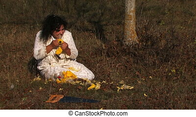 Mad Dark Haired Woman In White Shirt Tearing Stuffed Toy At Nature