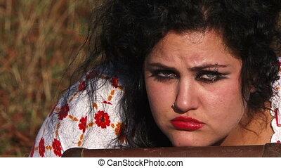 Sad Dark Haired Woman Looking At Camera At Nature