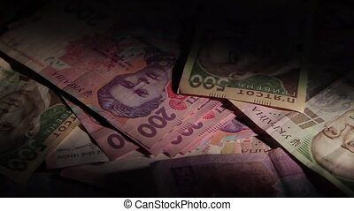 Money rotate on the table. Bills and coins. The overall plan. Hryvnia. shadow