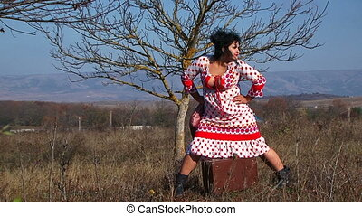 Young Woman In White Dotted Dress Posing At Nature - This is...