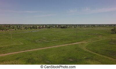 Rural land with suburban areas. West Siberian Plain. Omsk...