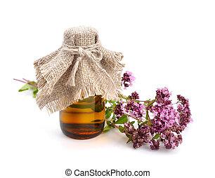 Oregano flowers with pharmaceutical bottle.