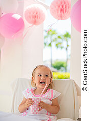 Little Girl Celebrate Happy Birthday Party With Pink Decor...