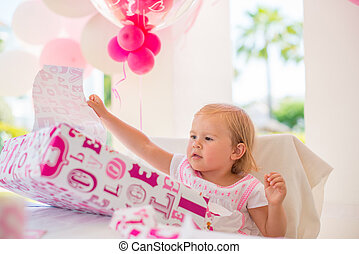Excited Cutie Unwrapping Her Birthday Present. Outdoor Party...