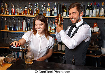 Bartender and a waitress in the bar - Portrait of a waitress...