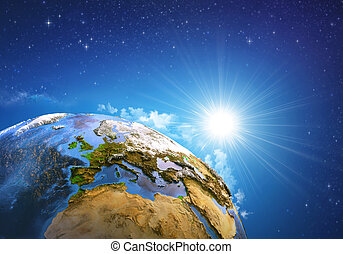 Sunrise over the Earth - Rising sun over the Earth and its...