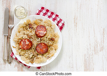 portuguese dish duck rice on white plate with wine