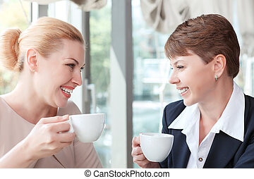 Businesswomen during a business lunch - Close up portrait of...